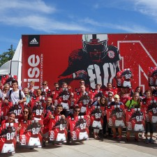 adidas brand ambassadors at the University of Nebraska pose with football posters