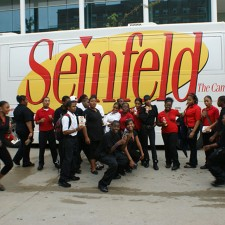 Sony brand ambassadors have a little fun outside the Seinfeld Campus Tour bus.