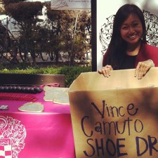 A Vince Camuto brand ambassador collects shoes for a shoe drive on campus