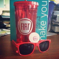 Marketing to millennials with branded promotional items like Fiat travel cups, ping pongs and sunglasses