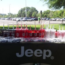 Marketing to millennials with branded promotional items like Jeep travel cups and sunglasses