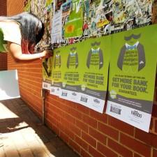 Neebo brand ambassadors post informational fliers around campus