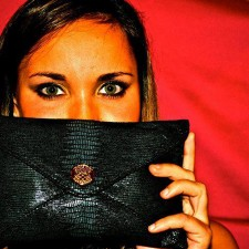 Vince Camuto brand ambassador shows off a clutch