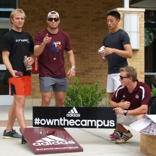Texas A&M college brand ambassadors play a little cornhole in their adidas gear
