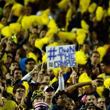Peer to peer marketing amid a sea of yellow at a University of Michigan game