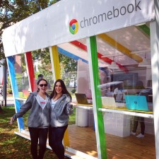 a couple of google chromebook brand ambassadors wait at the lending library to help their peers