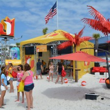 Secret Oasis tent on the shores of Panama City Beach is part of the experiential marketing to millennials during spring break