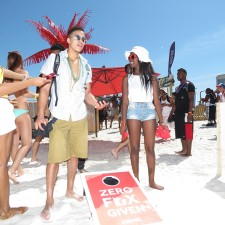 Experiential marketing: College co-eds play Social corn hole in the sand at Panama City Beach