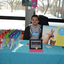 Peer to peer marketing: STA Travel college ambassador at promo table
