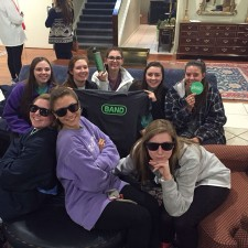 A group of college females proudly sport their Band shades, t-shirts & waterbottles: marketing to millennials