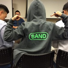 Peer to peer marketing in a Band hoodie
