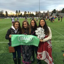 College brand ambassadors hold up a Band banner during a campus flag football game
