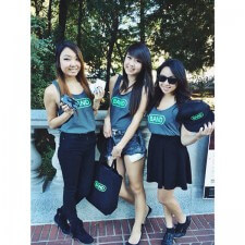 College brand ambassadors sport various Band promotional items, including tank tops, hats and tote bags