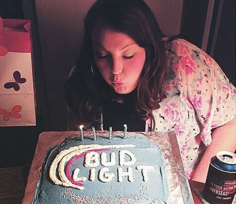 Bud Light brand ambassador blows out candles on cake