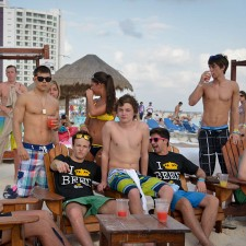 Corona's marketing to millennials includes Cancun beach lounges and Corona wear