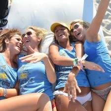 College females sport Corona tank tops on the beach