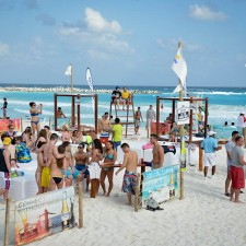 Co-eds gather in Corona's Cancun beach lounges, a part of the experiential marketing campaign