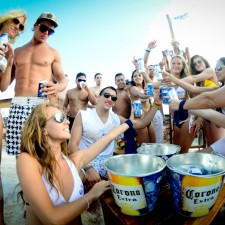 Co-eds grab beers from Corona pails in beach lounges as part of the experiential marketing campaign