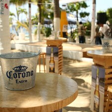 Marketing to millenials with Corona beer pails in beach lounges in Mexico