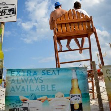 Banners part of Corona's marketing to millennials on the beaches in Mexico
