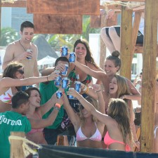 Experiential marketing: college co-eds enjoy Corona together in a beach lounge in Cancun