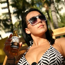 A college student on spring break enjoys a Corona with lime