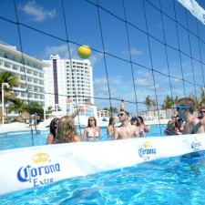 College co-eds play beach volleyball in the pool as part of Corona's experiential marketing campaign in Mexicio