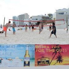 College co-eds play beach volleyball as part of Corona's experiential marketing campaign in Mexico