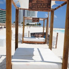 Shaded beach lounges offer Corona a setting to market to millennials on spring break in Cancun