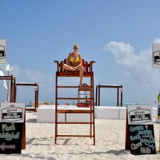 Marketing to millennials with Corona signage on Cancun's beaches during spring break