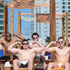Male millennials strike poses in Corona's beach lounges on the beaches of Cancun