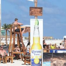 Corona's marketing to millennials with banners and signage on the Cancun beaches