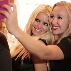 Jessica Simpson and brand rep taking selfie