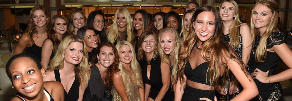brand reps pose with Jessica Simpson in New York City