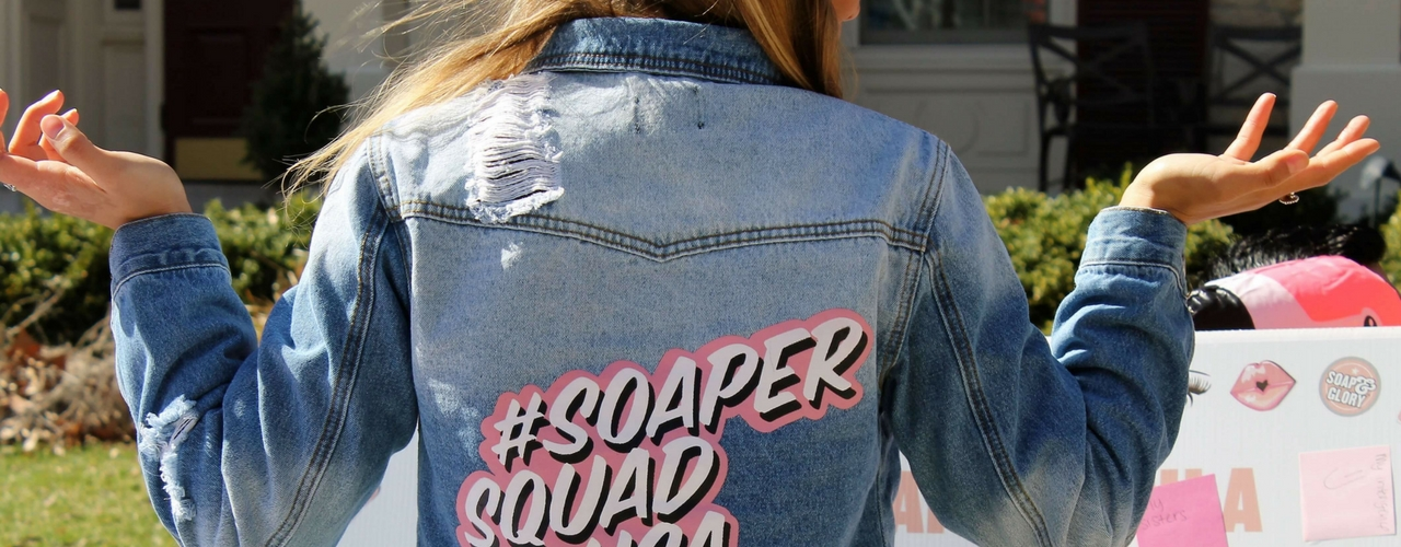 Soap and Glory campus rep wearing branded jacket