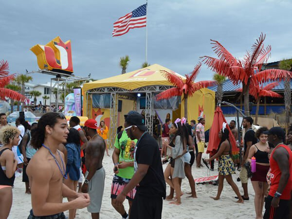 Secret Oasis tent crowded with college students in Panama City Beach