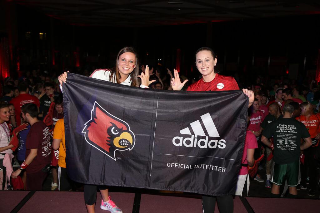 Adidas student brand ambassador holding Cardinals sign