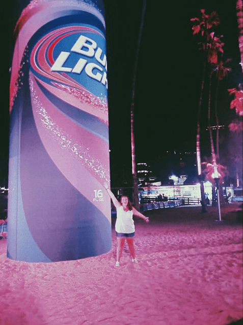 Bud Light brand ambassador in front of a giant can
